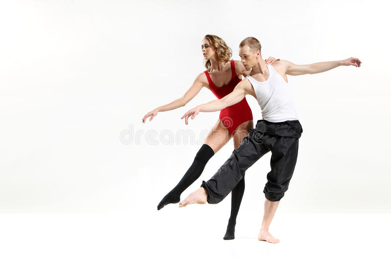 Dancing two people. Couple in a pose of modern dance women wearing a outfit stock photos