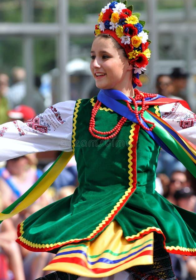 Dancing Ukranian girl. A young girl dances in traditional Ukranian clothing at Edmonton's capital Ex parade royalty free stock photography