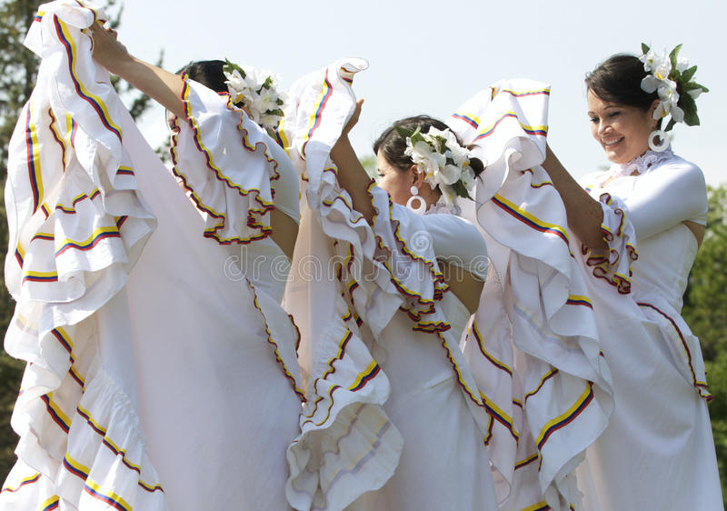 Dancing Uruguian girls. Young women from Uruguay perform a show for the public during Edmonton's Heritage days royalty free stock image