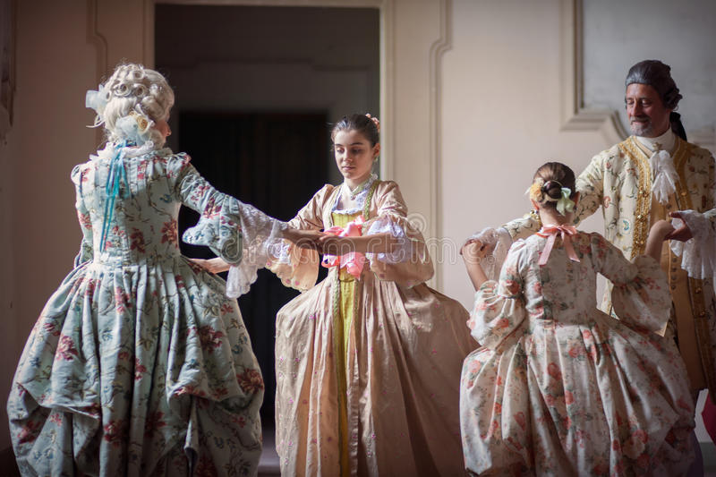 Dancing in Victorian dress royalty free stock image