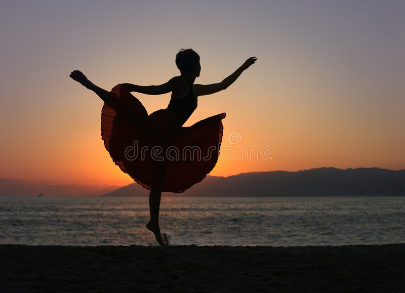Dancing woman on the beach royalty free stock photos
