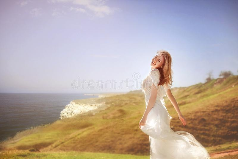 dancing woman on a cliff over the sea royalty free stock image