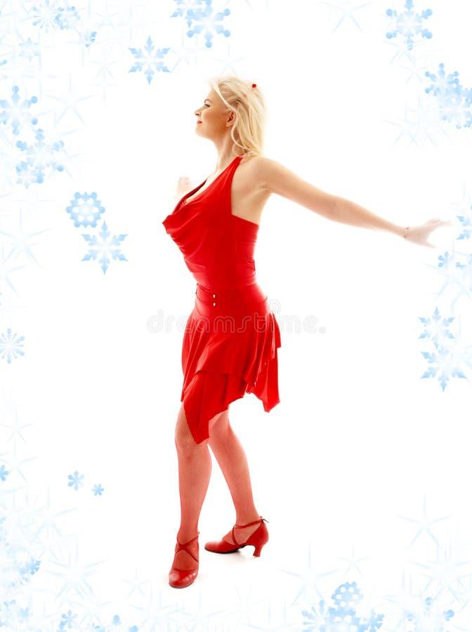 Dancingowa dama w czerwieni z płatkami śniegu fotografia royalty free