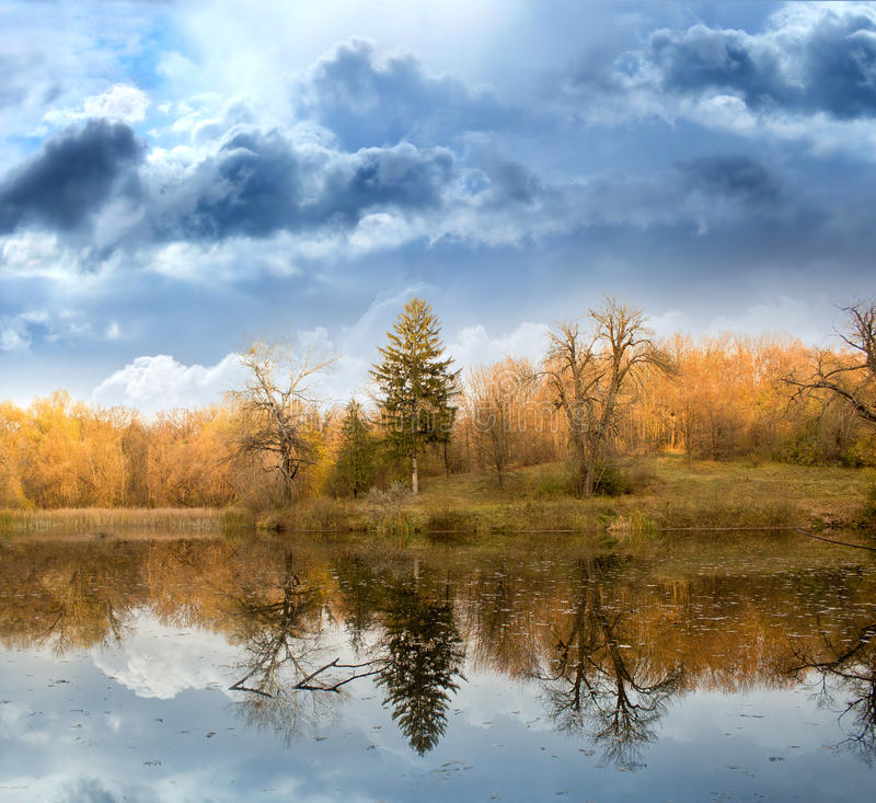 Autumn landscape against. Sky and the river stock photo