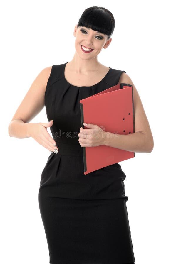 Dando boas-vindas à mulher de negócio assertiva profissional que guarda um arquivo fotografia de stock royalty free
