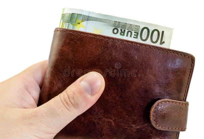 Dando el soborno de la cartera de cuero marrón con cientos euros aislados imagen de archivo libre de regalías