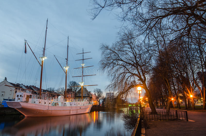 Dane river in Klaipeda (Lithuania). Klaipeda (Lithuania) at night. Old Town and Dane river. Ship Meridianas, 1948, the symbol of Klaipeda city royalty free stock photography
