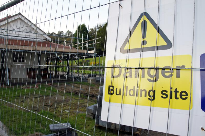 Danger Building site sign. Yellow and white sign saying Danger Building site stock image