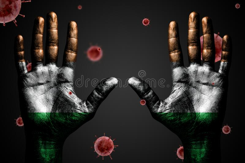 Danger concept from coronavirus, arms up with Ireland flag and flying bacteria Covid-19, on dark isolated background. horizontal. Danger concept from coronavirus royalty free stock image