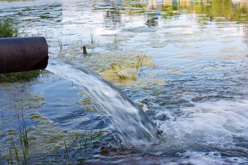 Danger of contamination of the environment. Toxic, Sewage drain royalty free stock image