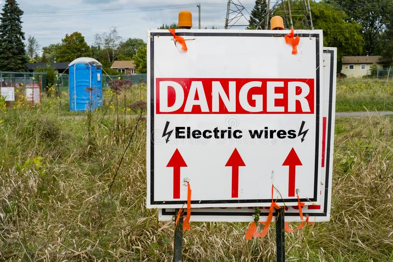 Danger Electric Wires Sign. With metting point in the back stock photography