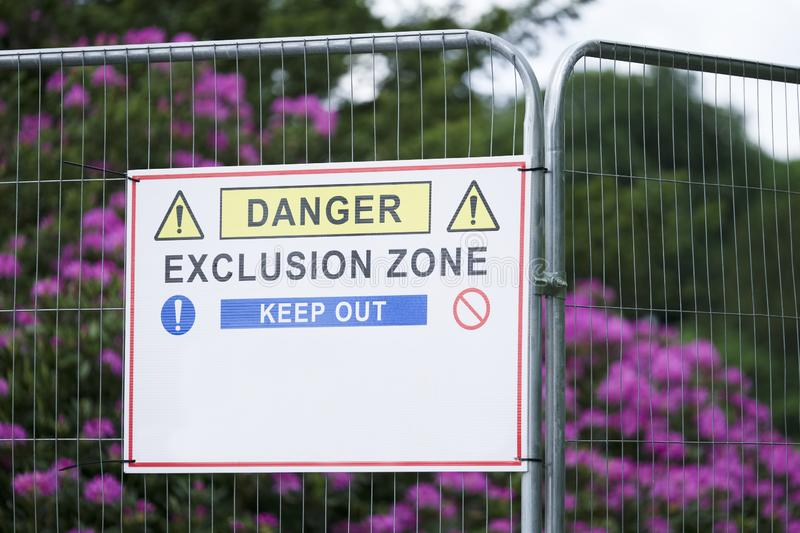 Danger exclusion zone keep out hares fence sign. Uk stock photo