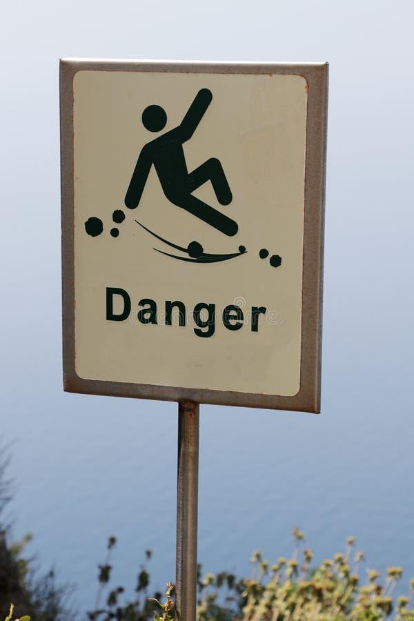 Danger of falling hazard sign.  stock photos