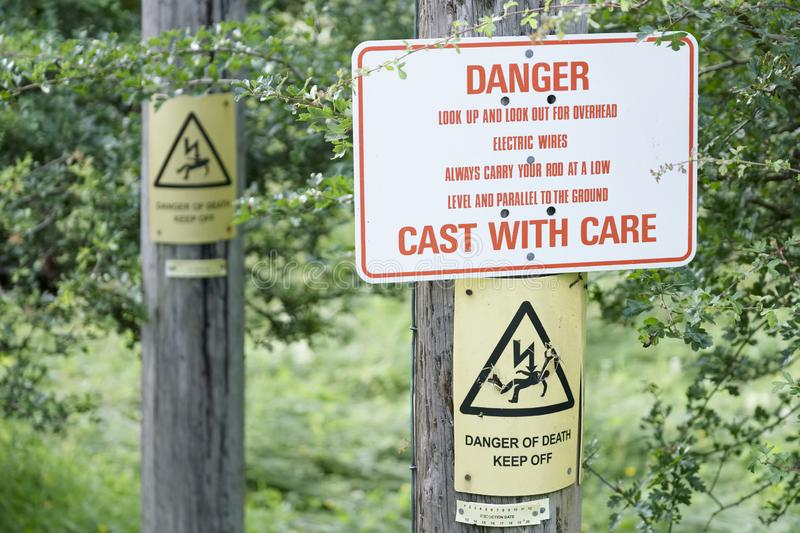 Danger for fishing cast with care electrical overhead cables sign. Uk royalty free stock photos