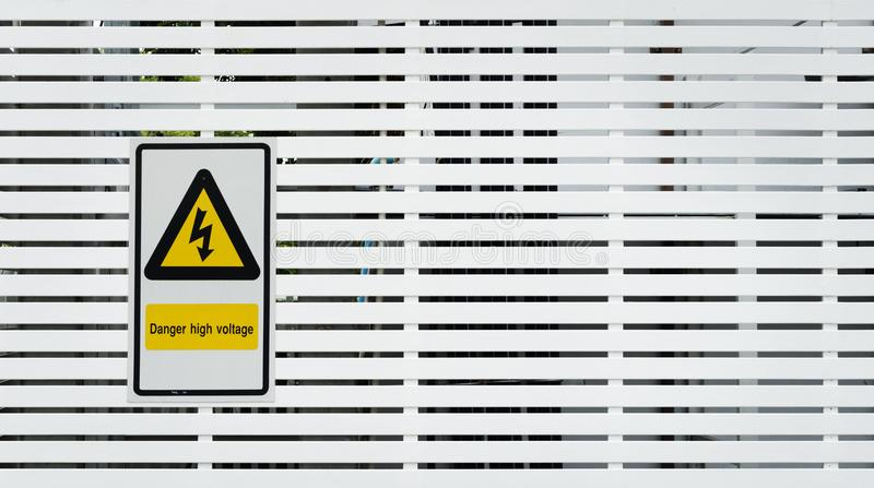 Danger high voltage sign and background photo royalty free stock image