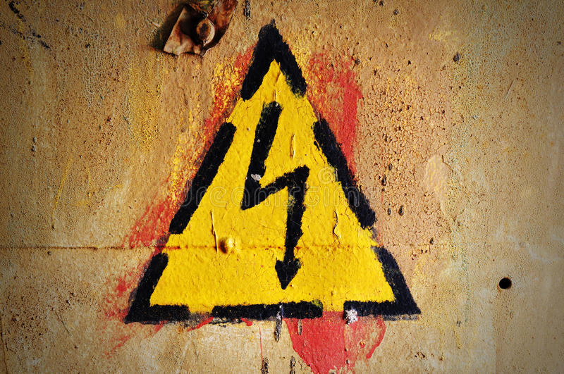 Danger: Keep out !. Yellow High Voltage warning sign on a grunge wall royalty free stock photos
