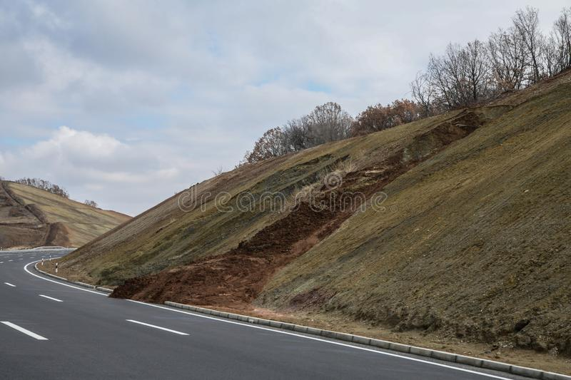 Danger landslide on the highway. Landslide on the access road royalty free stock image