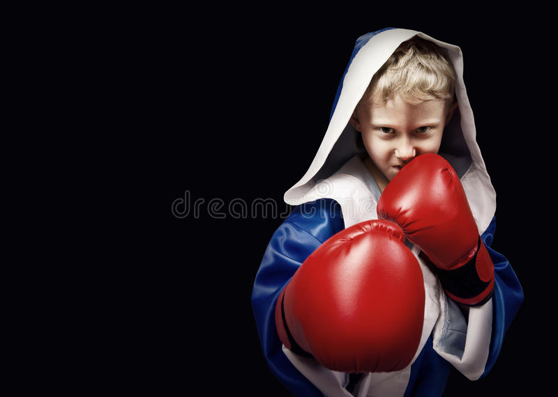 Danger looking little boxing fighter stock photo