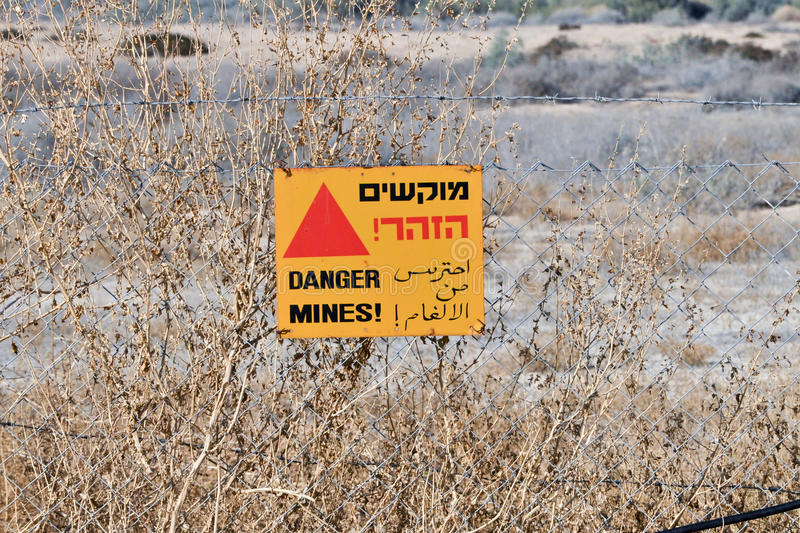 Danger Mines sign on a fence in Israel at Qasr el Yahud site royalty free stock photo