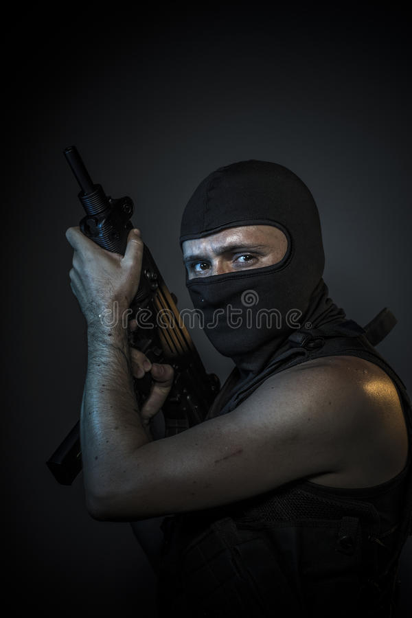 Danger, murderer with motorcycle helmet and guns. Scary stock photography