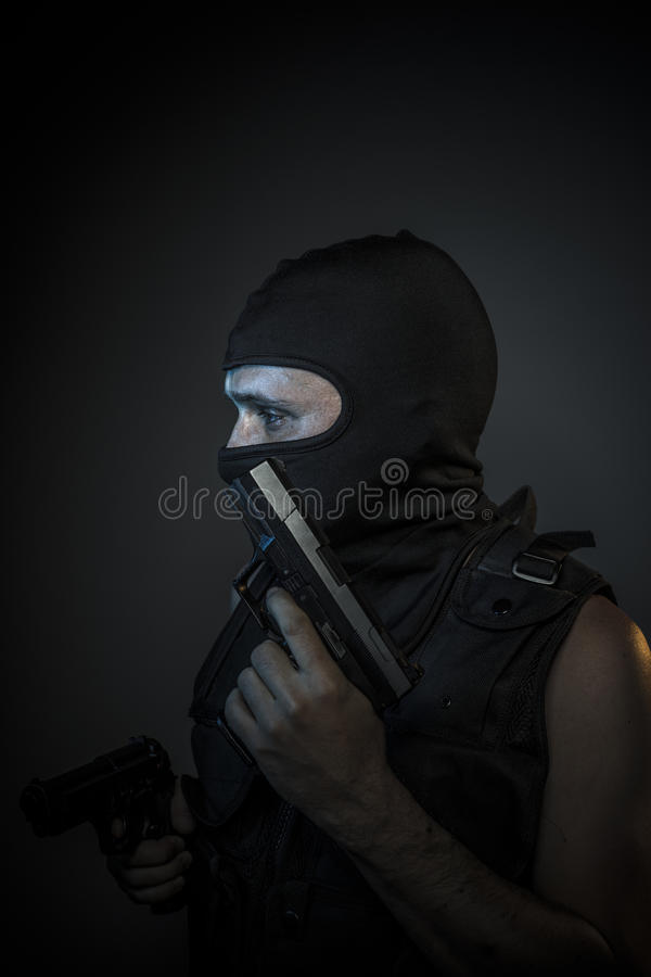 Free Danger, Murderer With Motorcycle Helmet And Guns Royalty Free Stock Photography - 57080117