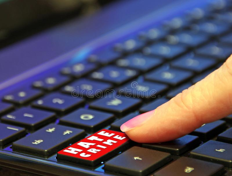 Danger online internet dark web hate crime user finger pressing pushing red button computer royalty free stock photography