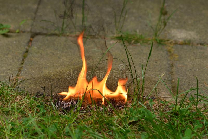 Danger with an open fire. In a garden near a house stock photography