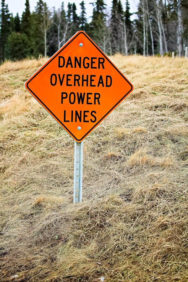 Danger overhead powerline sign in the country royalty free stock photos