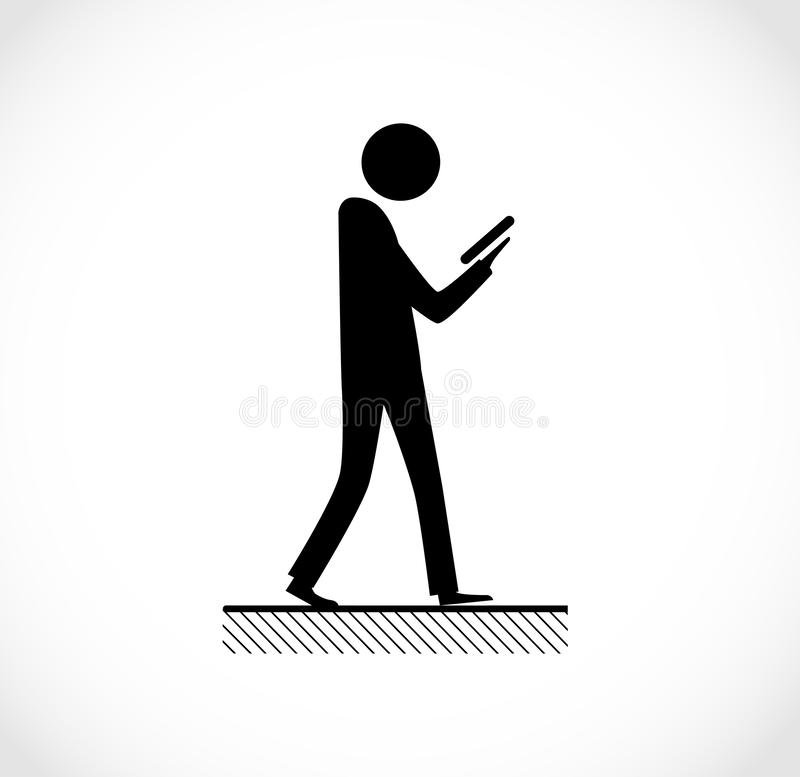 Danger on road sign concept - man with mobile phone walking through crossroad royalty free stock photos