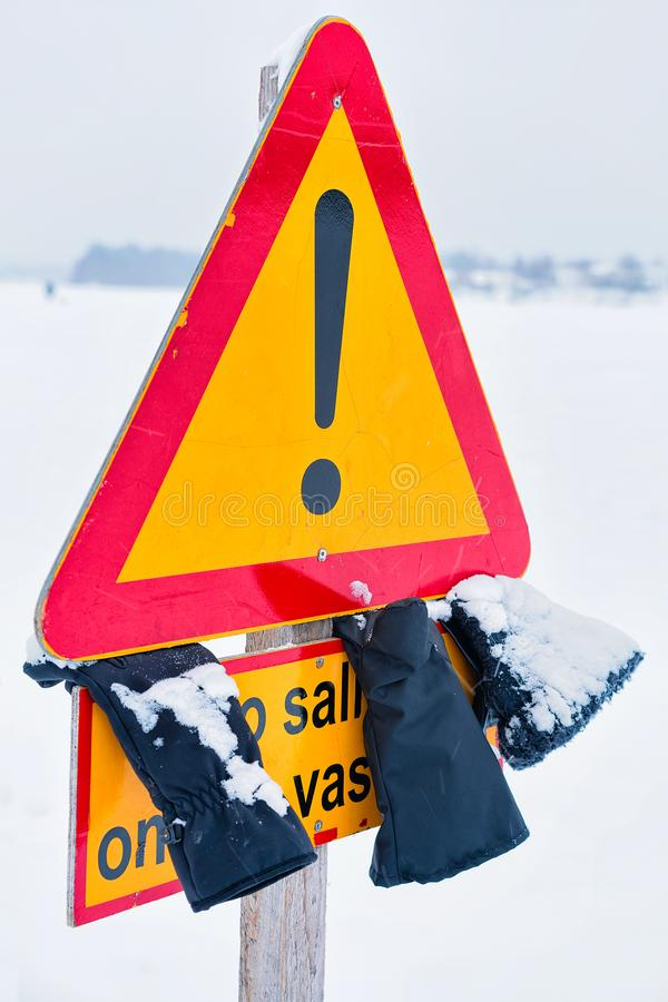 Danger Road sign in street in winter Rovaniemi royalty free stock photo