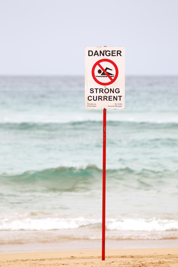 Danger Sign on the Beach. No swimming, danger sign at the beach of Manly, Sydney, Australia warning against strong currents stock image