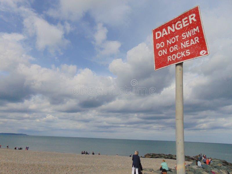 Danger Sign on Beach royalty free stock photos