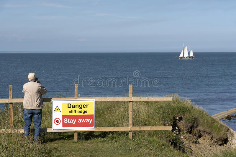 Danger sign on a cliff edge royalty free stock images