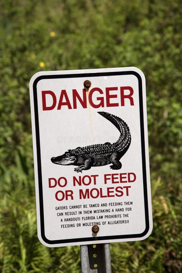 Danger sign. Florida USA. Aligator danger and warning sign Florida USA April 2017 Do not feed or molest gators stock photo