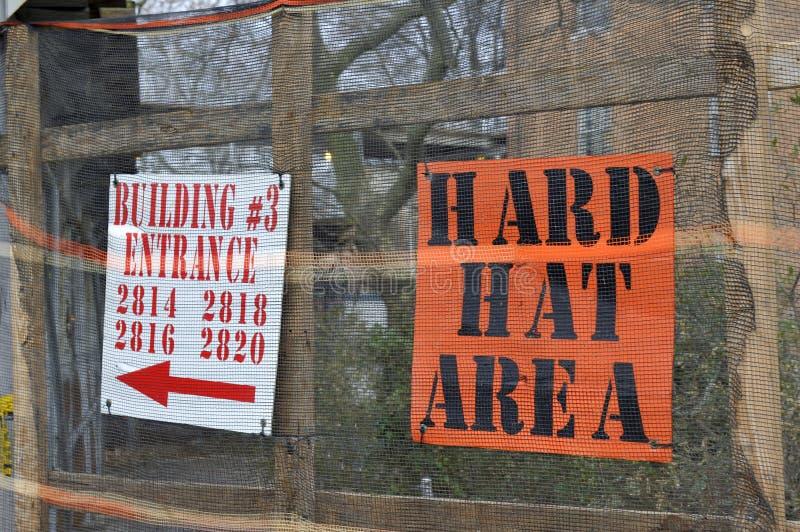 Danger sign - hard hat area stock image