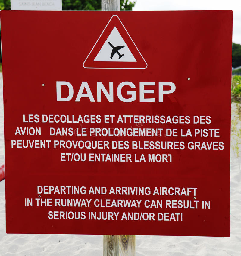 Danger sign next to runway at Gustaf III Airport at St Barts , French West Indies stock image