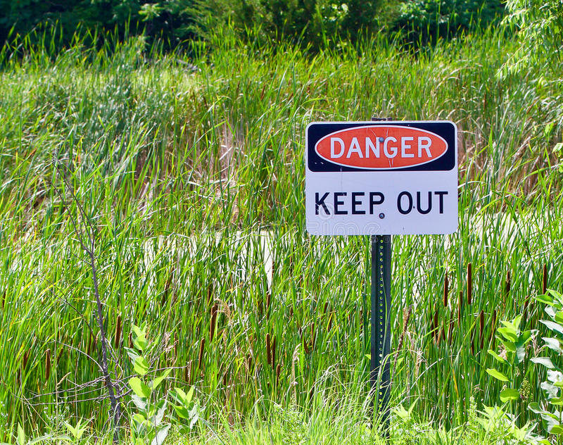 Danger Sign. Red, black and white danger sign stock photos