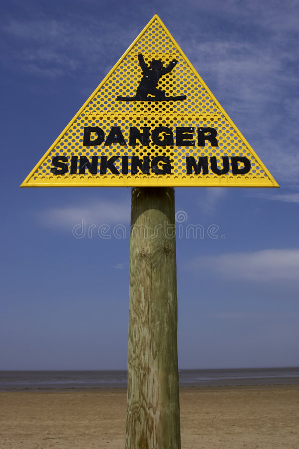 Danger sinking mud sign, sand point beach England uk stock images