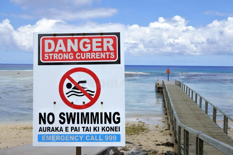 Danger Strong Currents - No Swimming sign. The most dangerous water hazard in Rarotonga in the Cook Islands, are the channels linking the lagoon into the ocean royalty free stock photo