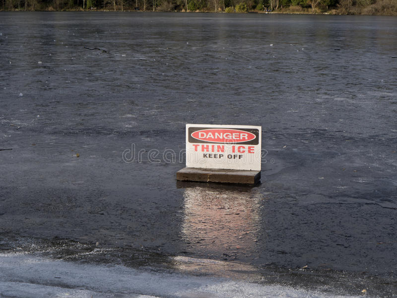 Danger, Thin Ice. Danger Thin Ice sign placed to discourage reckless people of walking on the ice and putting themselves in danger royalty free stock photos