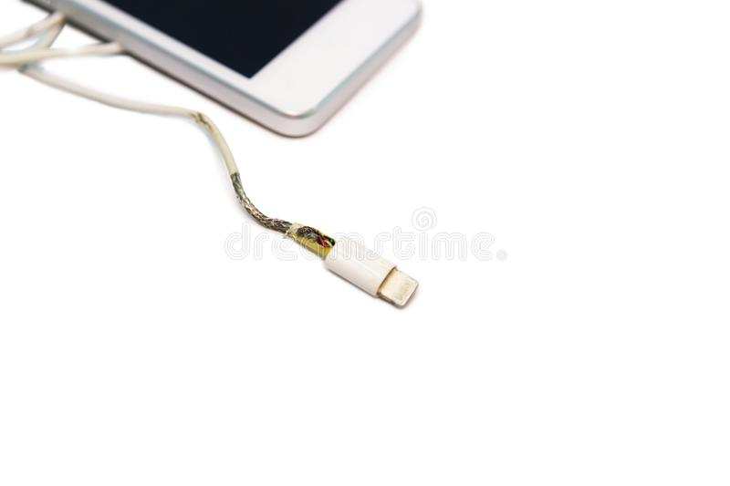 Danger unsafe cable Phone Charger Lack of damage on white background. Concept danger for cable unsafe copy space royalty free stock photo