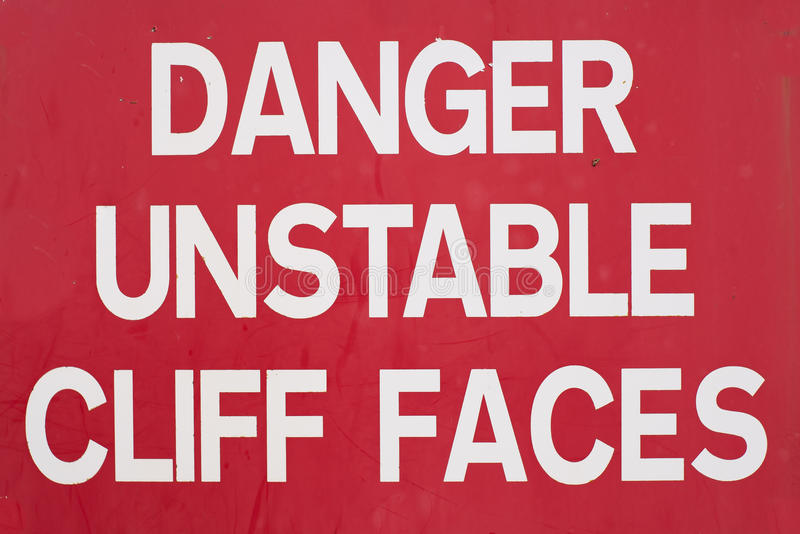 Danger unstable cliff sign royalty free stock photography