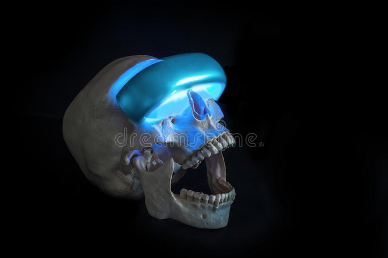 Danger of VR. Horrors of future technology. Skull in VR glasses. Concept, black background copy space stock photo