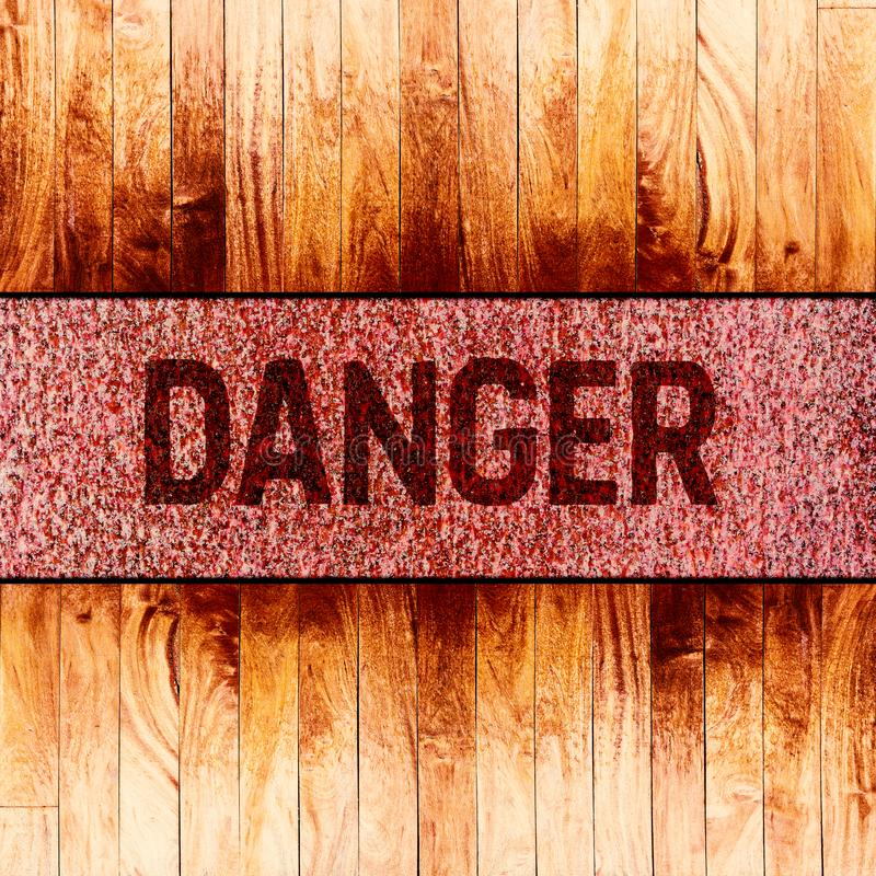 Danger warning sign text on rusty metal background royalty free stock image
