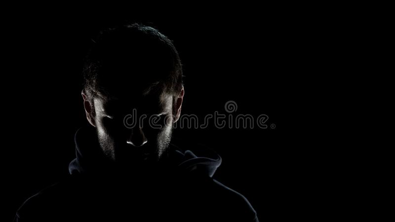 Dangerous anonymous male in night darkness, scary terrorist preparing for crime royalty free stock images
