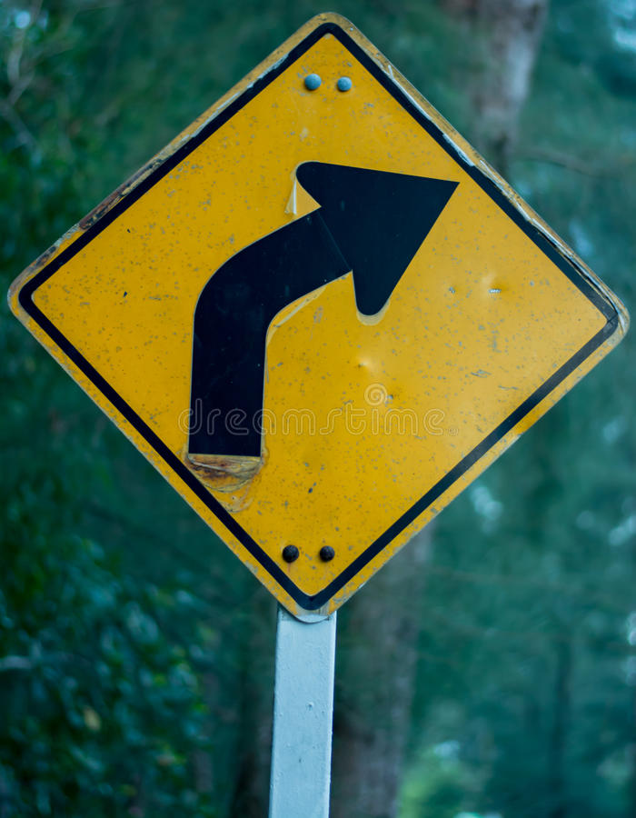 Dangerous bend ahead stock photography