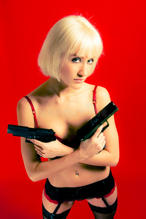 Download Dangerous blond woman stock photo. Image of stylish, weapon - 8519748