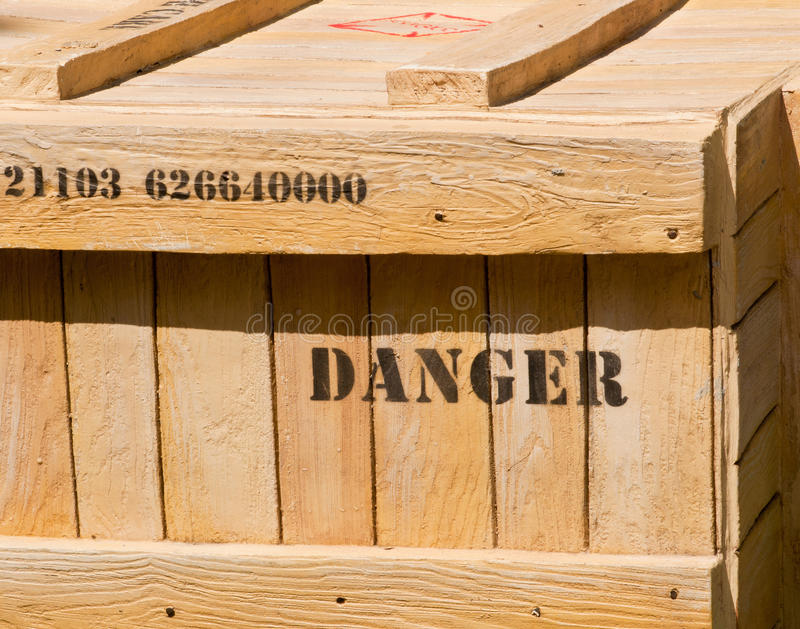Dangerous Cargo. A Concept of Dangerous Cargo with a Danger Word Printed on the Crate royalty free stock images