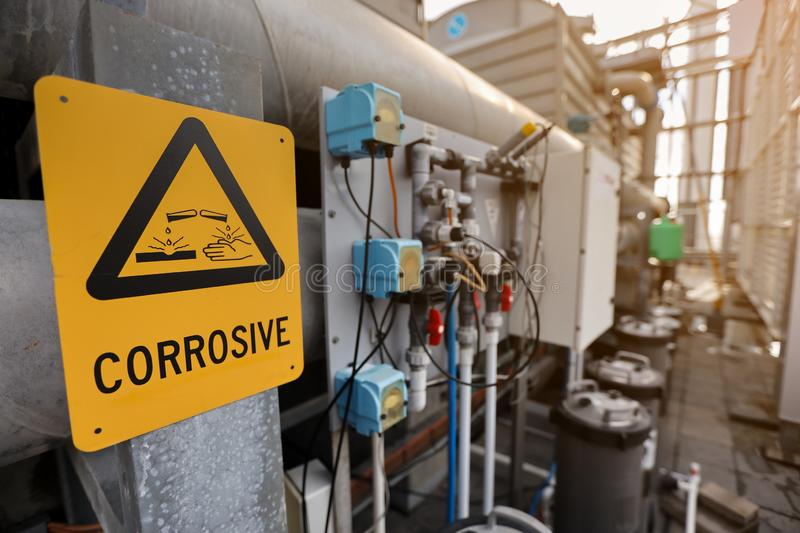Dangerous corrosive warning signs and symbol. Applying where chemical material substance storage used on construction site royalty free stock photo