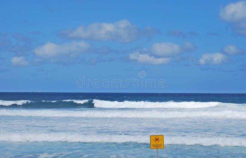 Dangerous currents sign on Bondi Beach. Dangerous currents sign swimming restriction on Bondi Beach royalty free stock photos